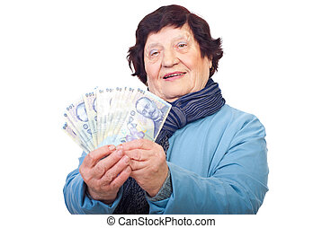 Senior woman holding Romanian money