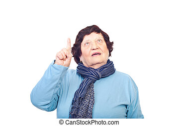 Elderly woman pointing up