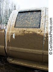 Side door of a truck that has been mud bogging.