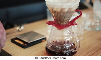 Barista prepares Pour Over, Chemex Dripping hot fresh...