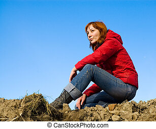 woman sitting on the ground