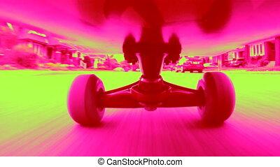 Dayglo Skateboard. - Riding a skateboard down an urban...