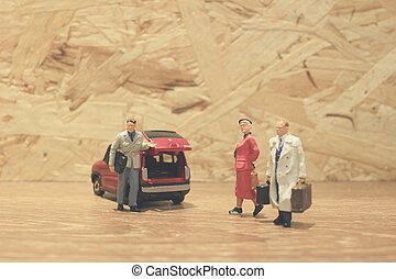 Mini businessman and tourist people with car