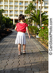 Young child with key - Young child walking with hotel key in...