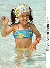 Child waving in pool