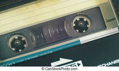 Insert an Audio Cassette into a Cassette Player and...