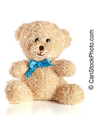 Toy teddy bear with blue bow isolated on white background.
