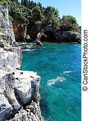 jumping from a cliff in the ocean