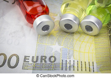 vials with different substances over euros, concept of...