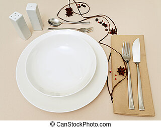 place settings - decorated place settings at a dining table