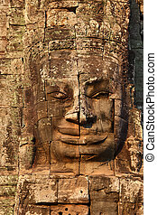 Giant stone face at Bayon Temple in Cambodia - Giant stone...