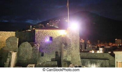 Old town of Budva at night. View from citadel. Adriatic sea...