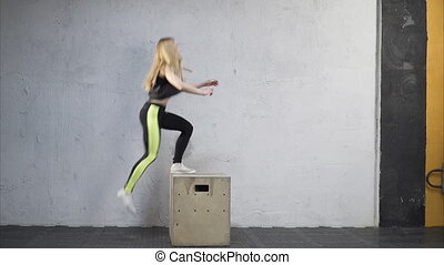 woman jumping up on the box