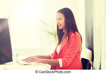 happy african woman with computer at office