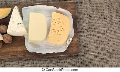 Expensive cheeses with walnuts