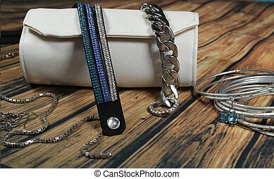 Women jewellery and white bag - These are jewellery and...
