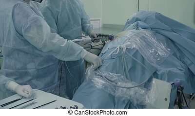 Laparoscopic surgery of the abdomen. The team of medical...