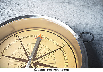 Orienteering concept - Close up of amber compass on light...