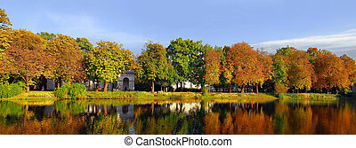 Autumn panorama - Walking area around the lake in Lazienki...