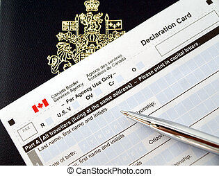 Canada passport on declaration card with pen
