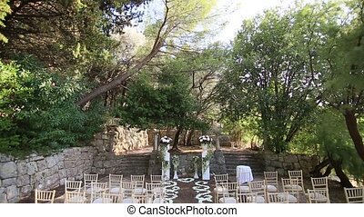 Visiting the wedding ceremony in the woods. Villa Milocer in...