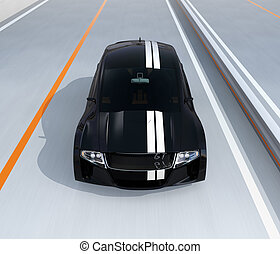 Front view of black electric sports car on the highway