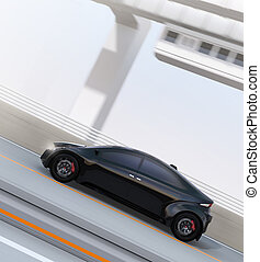 Side view of black electric sports car driving on the...