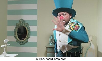 Magician in blue suit and hat manipulates waving a magic wand 4k