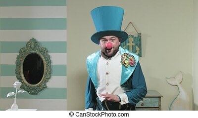 Magician in blue suit and hat manipulates waving a magic...