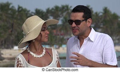 Husband And Wife Talking On Vacation