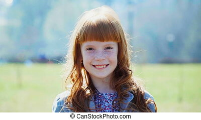 little ginger girl with freckles smiling - Cute little...
