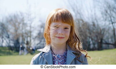 little ginger girl with freckles smiling - Close up...