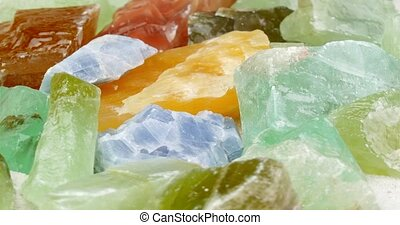 Several color calcite rotating close up - Several multi...