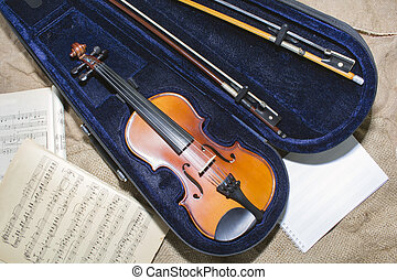 Violin neck on music papers background. Foto