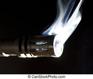 smoking gun - gun and its barrel that are putting out a lot...