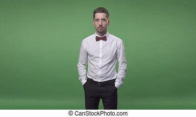 man in a white shirt with a bow-tie