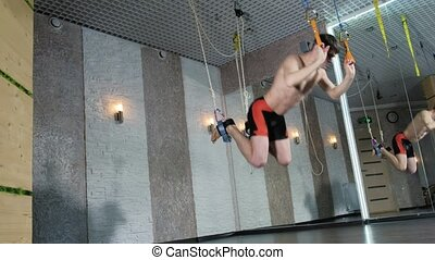 A man performs exercises alfagraviti in the studio 4k - A...
