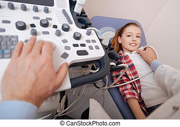 Cute girl enjoying ultrasound examination in the hospital