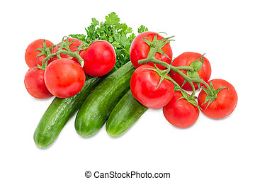 Cucumbers and two branches of the ripe red tomatoes