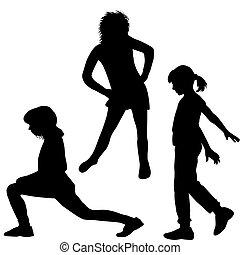 Silhouette of children doing exercises