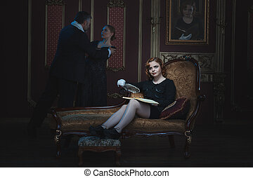 Woman writer writing a novel. A book about an old tyrant and...