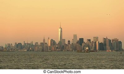 New York City Manhattan downtown skyline at dusk with...