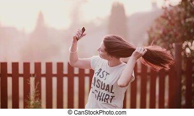 Young happy, joyful girl enjoying nature, turning, having...