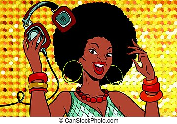 African American woman DJ with headphones. Audio and music....