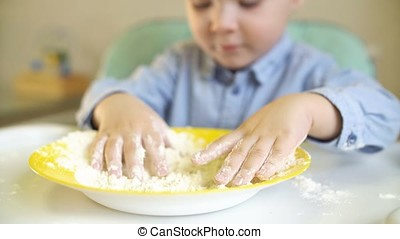 Little baby Touches Flour in The Kitchen.