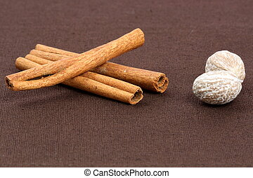 baking and cooking ingredients - fancy cinnamon sticks and...
