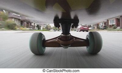 Skateboard. - Riding a skateboard down an urban street. Shot...