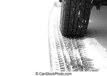 Truck Tire in Snow with Tread for Safety - Truck tire in...