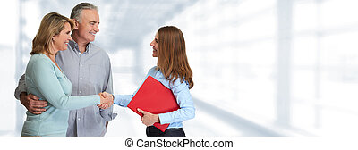 Senior couple with estate agent - Mature couple meeting with...
