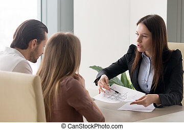 Buying new house concept, real estate agent consulting young...